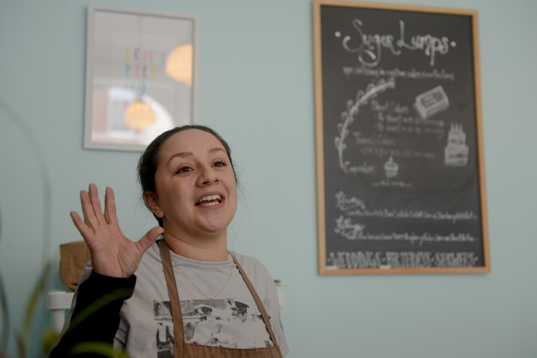 "Anastasia Lozoano-Garcia runs the Sugar Lumps bakery in downtown Fort Madison, Iowa. She voted early in the day at a satellite caucus on Monday, February 3, 2020. ""Bernie Sanders swept the caucus with four candidates,"" Lozoano-Garcia said, ""there was not that many people there and only people representing two campaigns showed up."""