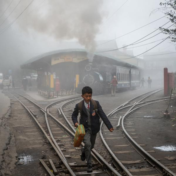A little boy runs along the train tracks outside of Ghum station as the steam-engine toy train prepares to depart in the Darjeeling area of West Bengal, India. The toy train, a main tourist attraction in the region, is fuelled by coal and emits hazardous smoke as it passes through towns and villages in the Himalayan foothills. Coal extends far beyond this tourist attraction. With a growing population and rising urbanization, the country still relies heavily on cheap, dirty energy -- coal -- in order to fuel the needs of a rapidly developing nation. According to the 2018 World Air Quality Report, 18 of the 20 most polluted cities in the world are in India and 1.24 million citizens die annually from air pollution. Copyright © Sara Hylton/Redux Pictures, 2019
