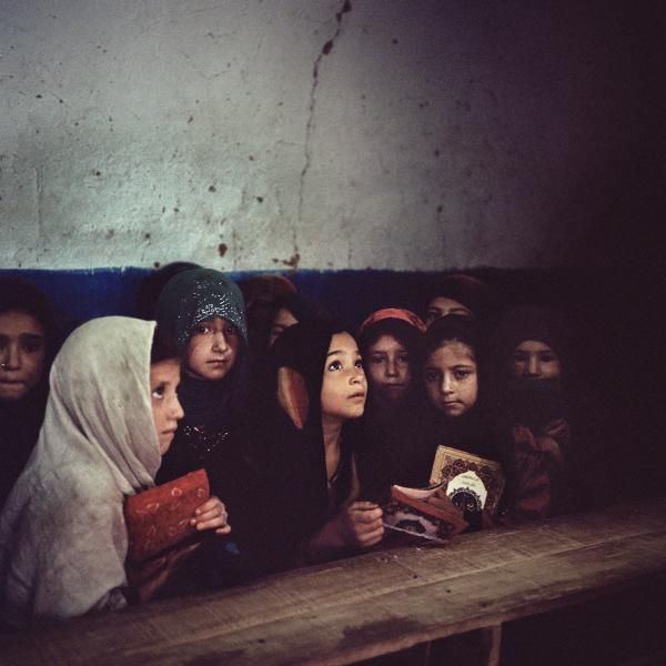 Girls at an Afghan refugee settlement on the outskirts of Islamabad, Pakistan study at a madrassa where they learn the Koran. For many Pakistani and Afghan families, madrassas are the only option to educate their girls. Religious schools provide Koranic teachings to approximately 3.5 million children and teens, but according to UNESCO only 18 percent of Afghan refugee girls are enrolled in schools in Pakistan. Copyright © Sara Hylton/Redux Pictures, 2018