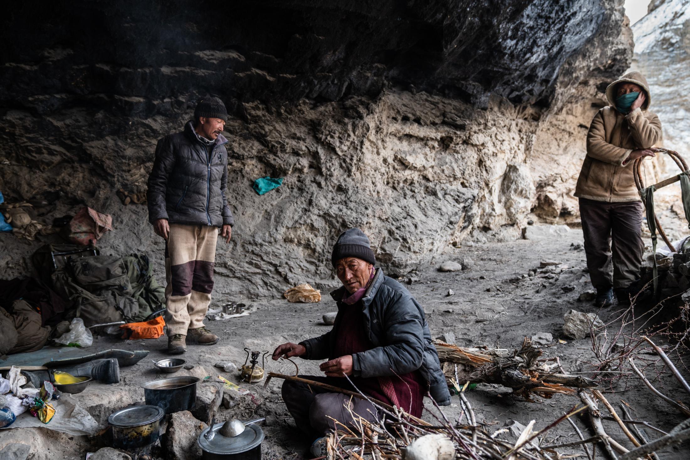 Zanskari's inside Tibb Cave preparing for the night.