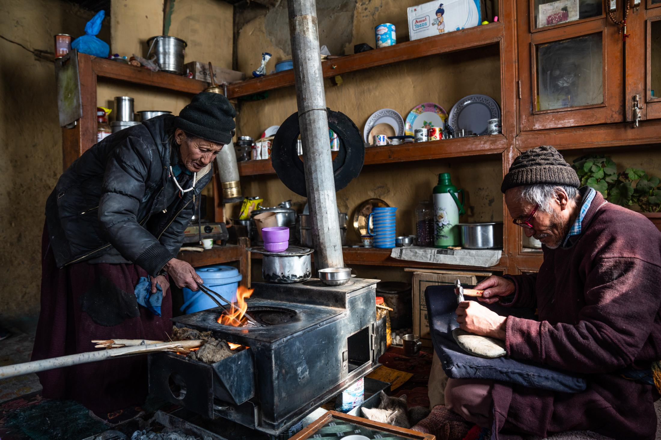 Husband and wife in the winter kitchen.