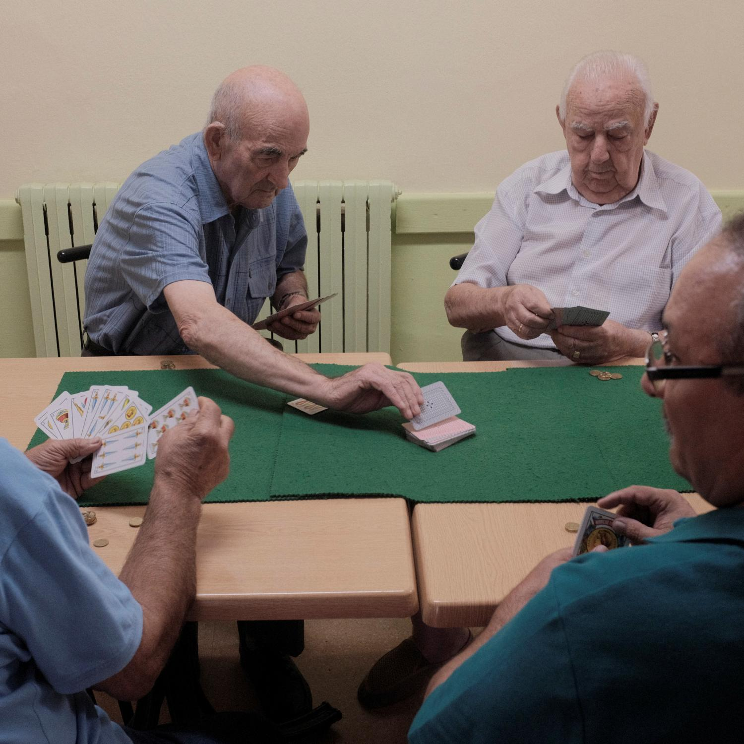 Retired farmers of Sodeto (Huesca), a settleds spot of no more than 200 inhabitants, playing a typical card game called Rabino in the only bar in town. After the Spanish civil war in 1936, under Francisco Franco´s dictatorship, an agriculture reform was enforced leading to the building of more than 300 new towns all around Spain. This towns were populated with people coming from other rural impoverished areas but most of them are in high risk of disappearing because the new generations are moving to cities and abandoning these areas. Copyright: Spanish photojournalist Andoni Lubaki.