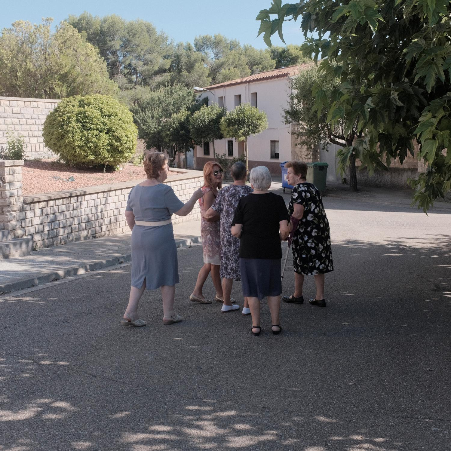 Old women group speaking after the church mass in Sodeto (Huesca). After the Spanish civil war in 1936, under Francisco Franco�s dictatorship, an agriculture reform was enforced leading to the building of more than 300 new towns all around Spain. This towns were populated with people coming from other rural impoverished areas but most of them are in high risk of disappearing because the new generations are moving to cities and abandoning these areas. Copyright: Spanish photojournalist Andoni Lubaki.