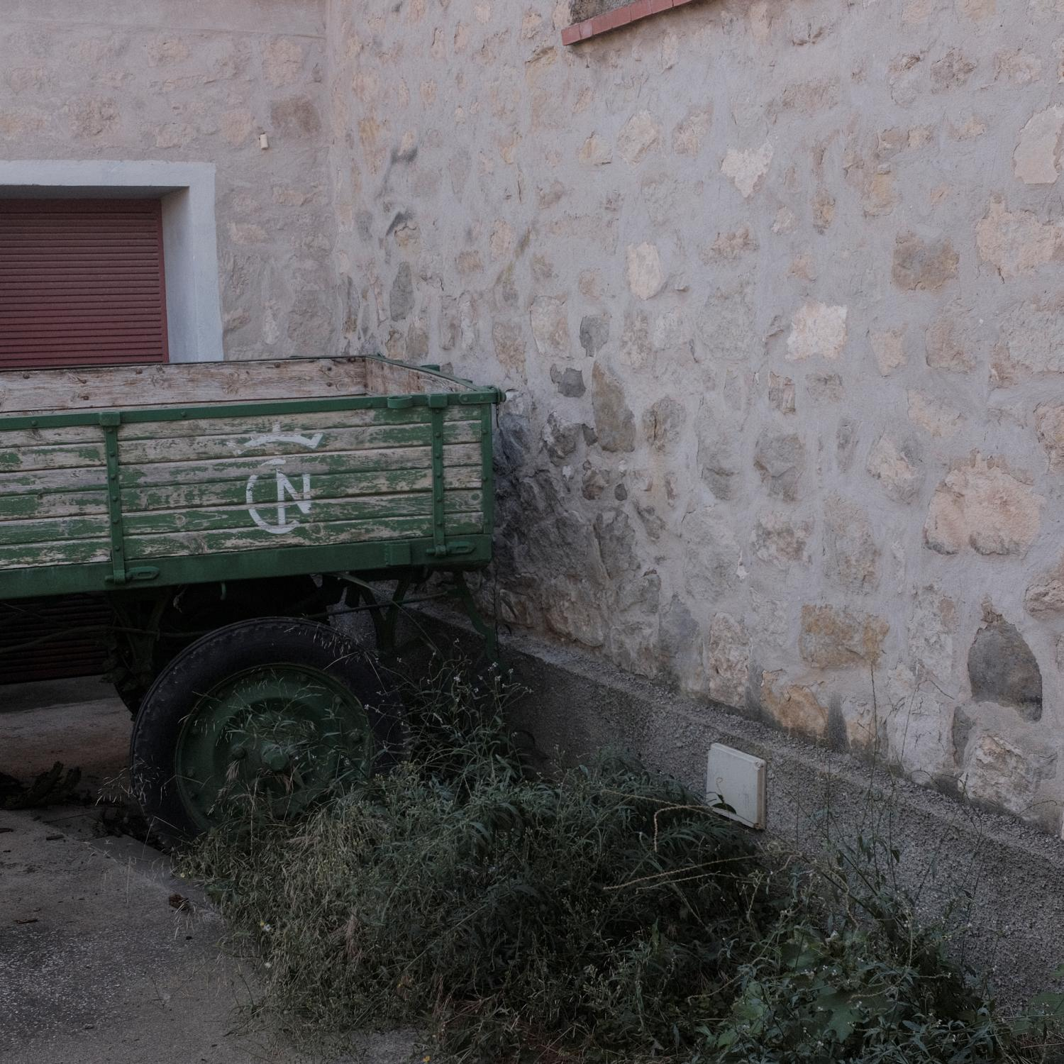 An old wagon with the logo of National Institute of Colonization inside the Settlers Museum in Sodeto (Huesca). After the Spanish civil war in 1936, under Francisco Franco�s dictatorship, an agriculture reform was enforced leading to the building of more than 300 new towns all around Spain. This towns were populated with people coming from other rural impoverished areas but most of them are in high risk of disappearing because the new generations are moving to cities and abandoning these areas. Copyright: Spanish photojournalist Andoni Lubaki.
