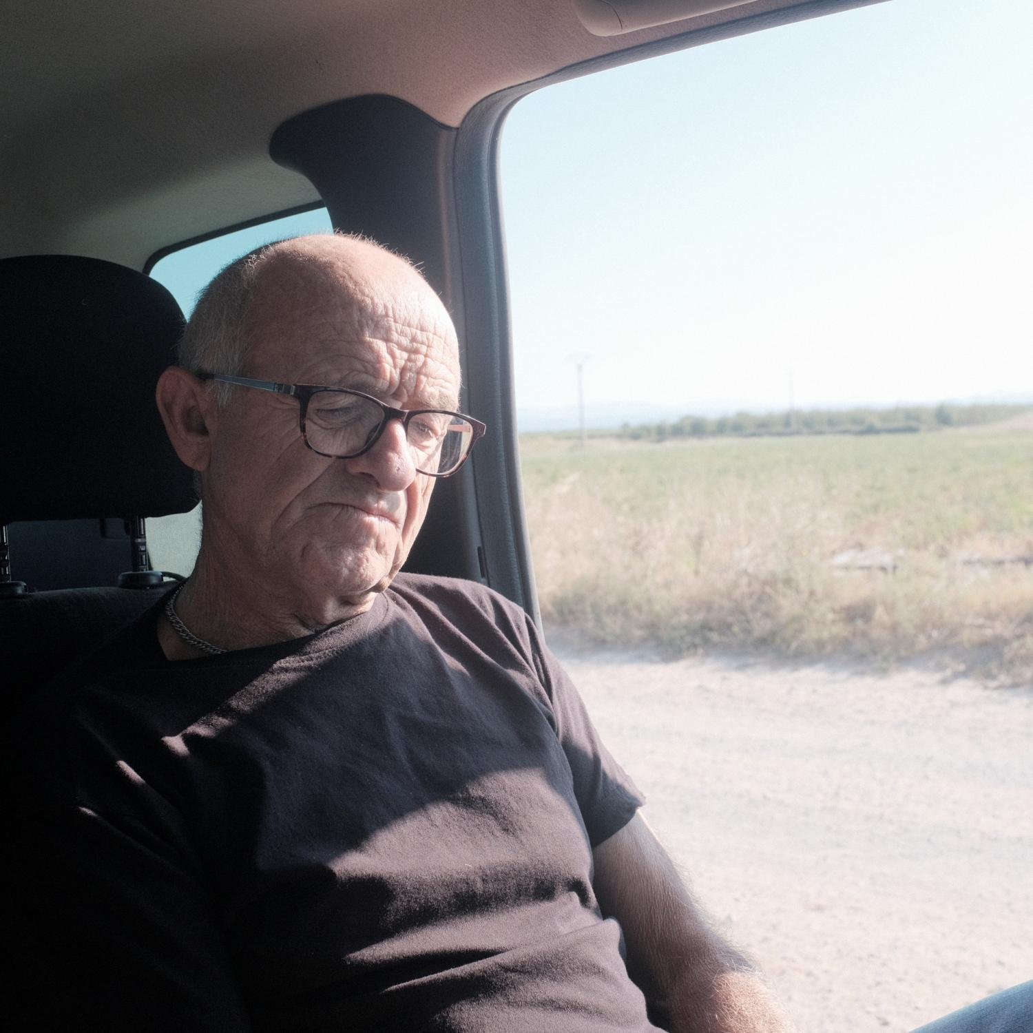 Donato Perez (63) thinking inside a car on the way to Bardenas was a Tiermas inhabitant (a town near the Pyrenees in Huesca that was forced to abandon due to construction of Yesa lake) when the government of Franco send him and his family to El Bayo a settler town in the north part of Zaragoza near the Monegros desert of Spain. After the Spanish civil war in 1936, under Francisco Franco�s dictatorship, an agriculture reform was enforced leading to the building of more than 300 new towns all around Spain. This towns were populated with people coming from other rural impoverished areas but most of them are in high risk of disappearing because the new generations are moving to cities and abandoning these areas Copyright: Spanish photojournalist Andoni Lubaki..