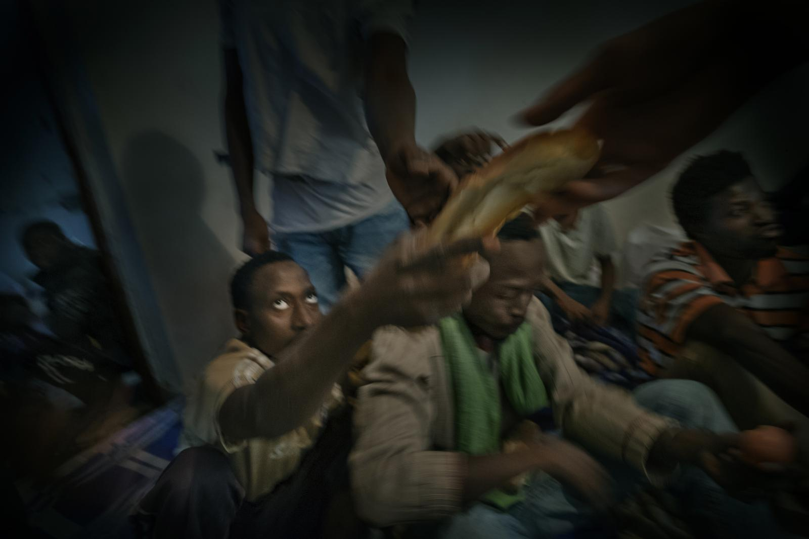 Food being handed out in a male-only detention centre in Milita, near Zauiya.