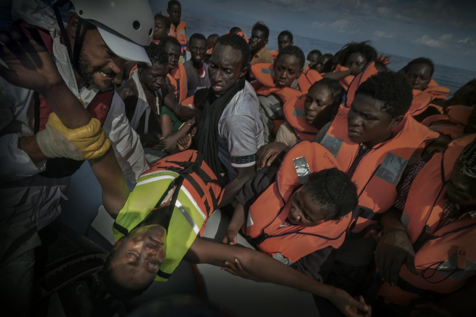 A member of the NGO Doctors Without Borders carries a refugee and migrant youth who has fainted aboard an inflatable boat during a rescue operation on the ship Dignity 1 on the Mediterranean Sea, off the coast of Libya. 373 migrants (from countries such as Nigeria, Ivory Coast, Sierra Leone, Mali and Niger), including 62 women and 10 children, were rescued in international waters off the shores of Libya.