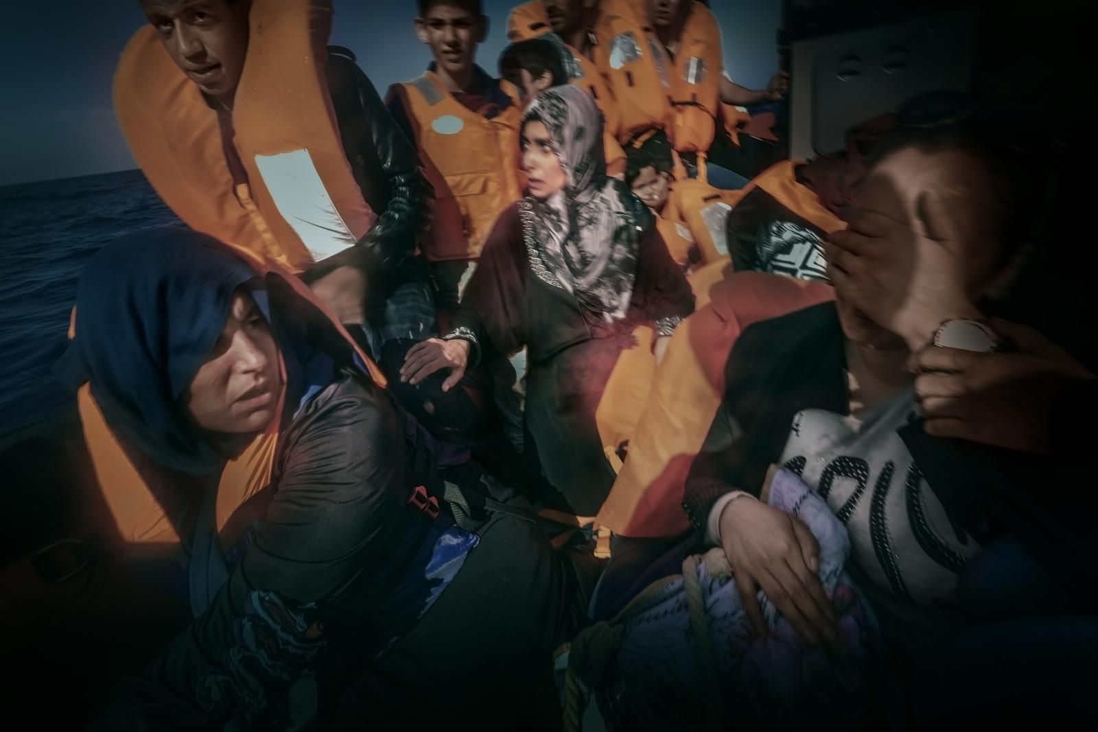Syrian and Libyan refugees (210 in all) rescued by members of the NGO Proactiva Open Arms, off the Mediterranean coast of the Libyan city of Sabratha, after their three wooden boats encountered problems. In the image, a woman is in shock.