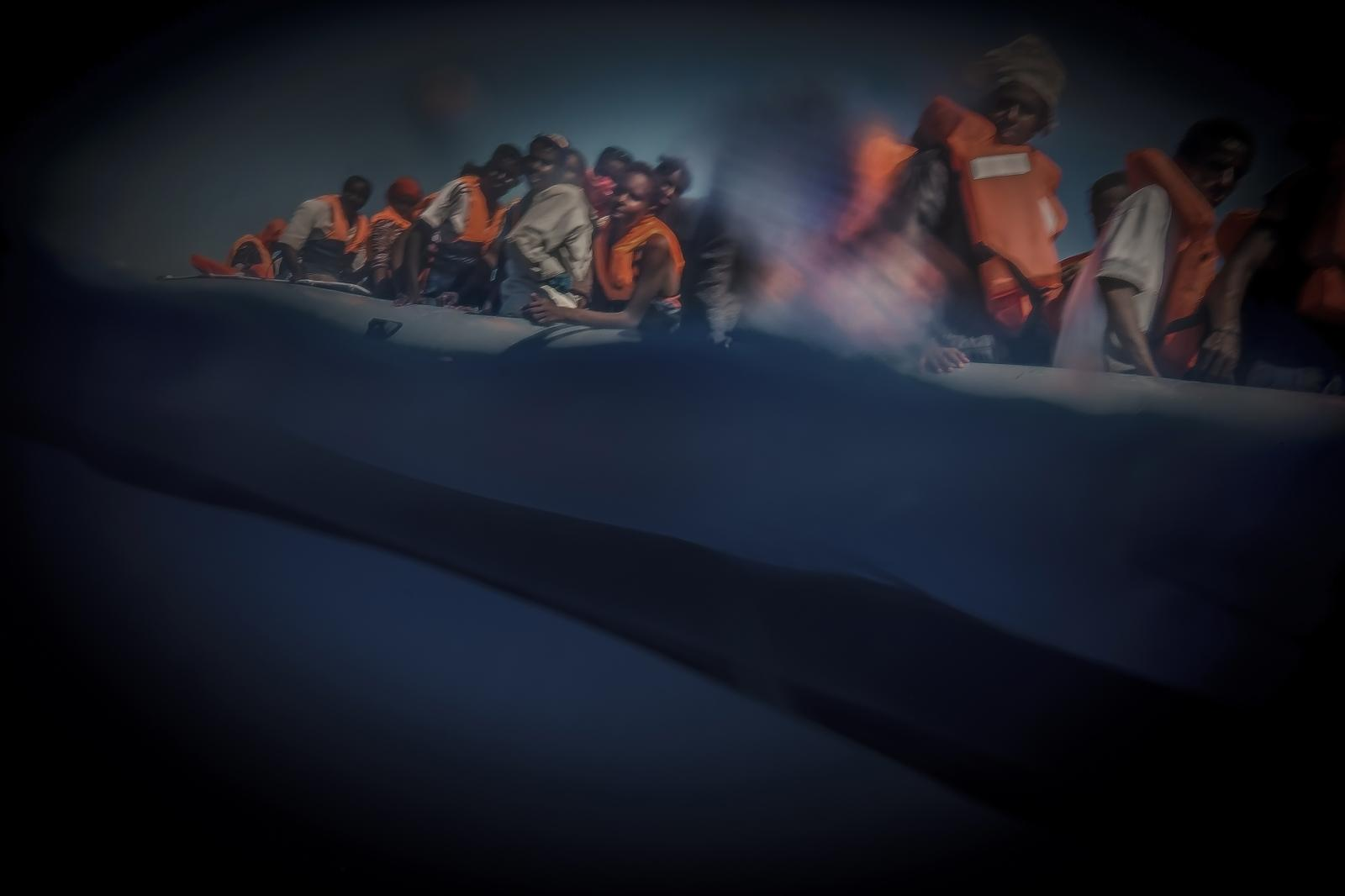 Refugees and migrants on the crossing from Libya to Europe on board fragile inflatable boats used to reach their destination.