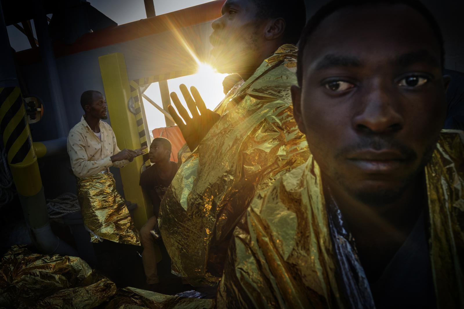 One of the refugees and migrants on board the rescue ship Bourbon Argos, also belonging to the NGO Doctors Without Borders, prays, offering thanks for being rescued.