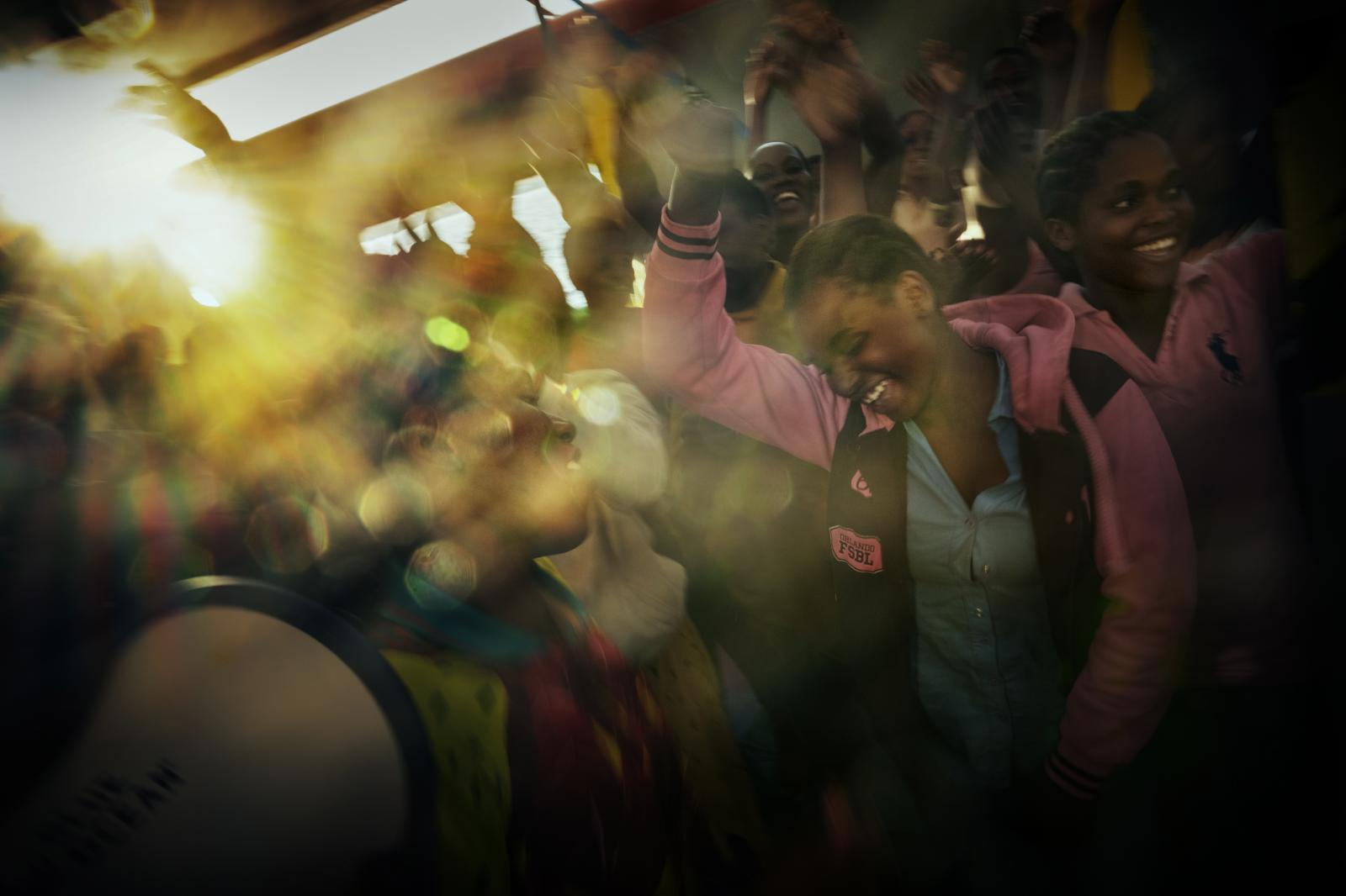 After two days on board the Doctors Without Borders ship Bourbon Argos, some refugees and migrants dance in celebration of their arrival to Calabria. Once on land, they will be transferred to detention centres on European soil.