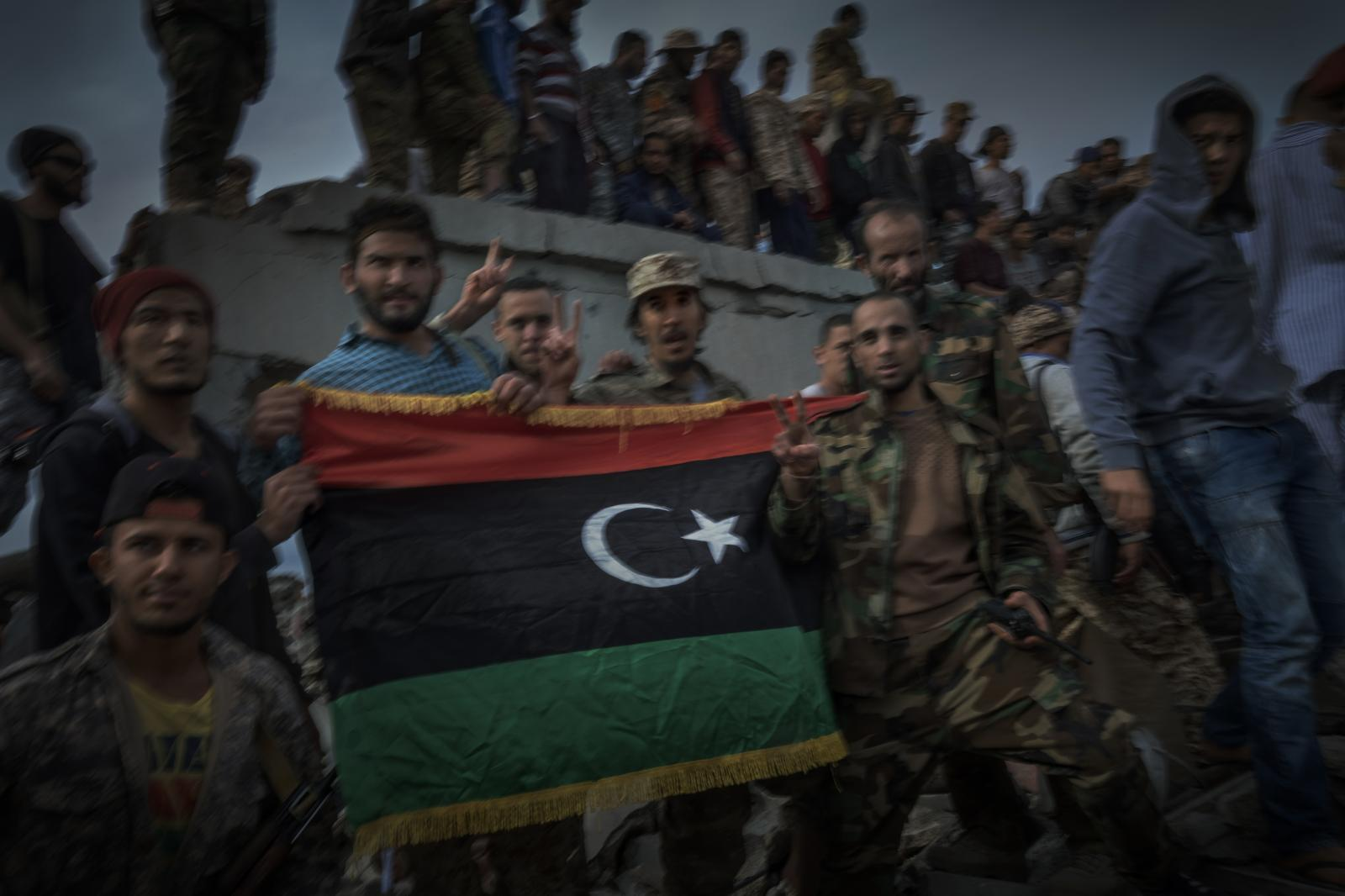 Celebrating the liberation of Sirte from ISIS's clutches. A last group of jihadists buried under the rubble threatened, that day, to blow themselves up. The soldiers had no choice but to douse the entire area in gasoline (2016).