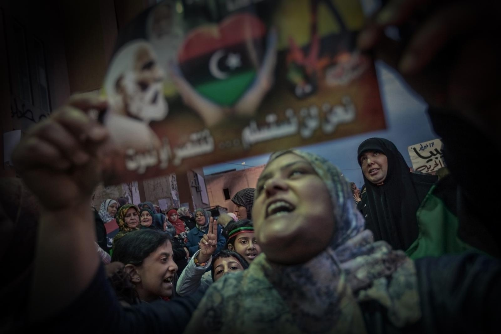 Protests in Bengasi with the image of Omar Al-Mujtar, hero of Libyan independence, call for international intervention and the imposition of a no-fly zone, just before Gaddafi's troops arrived at the gates of the besieged city and were stopped by French aircraft (2011).