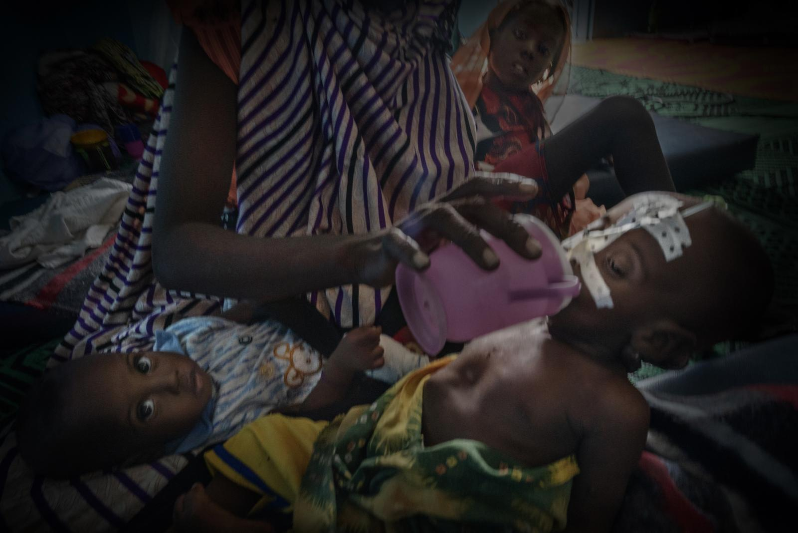A mother feeds her child suffering from malnutrition in Bokoro hospital, managed by the NGO Doctors Without Borders (Chad).
