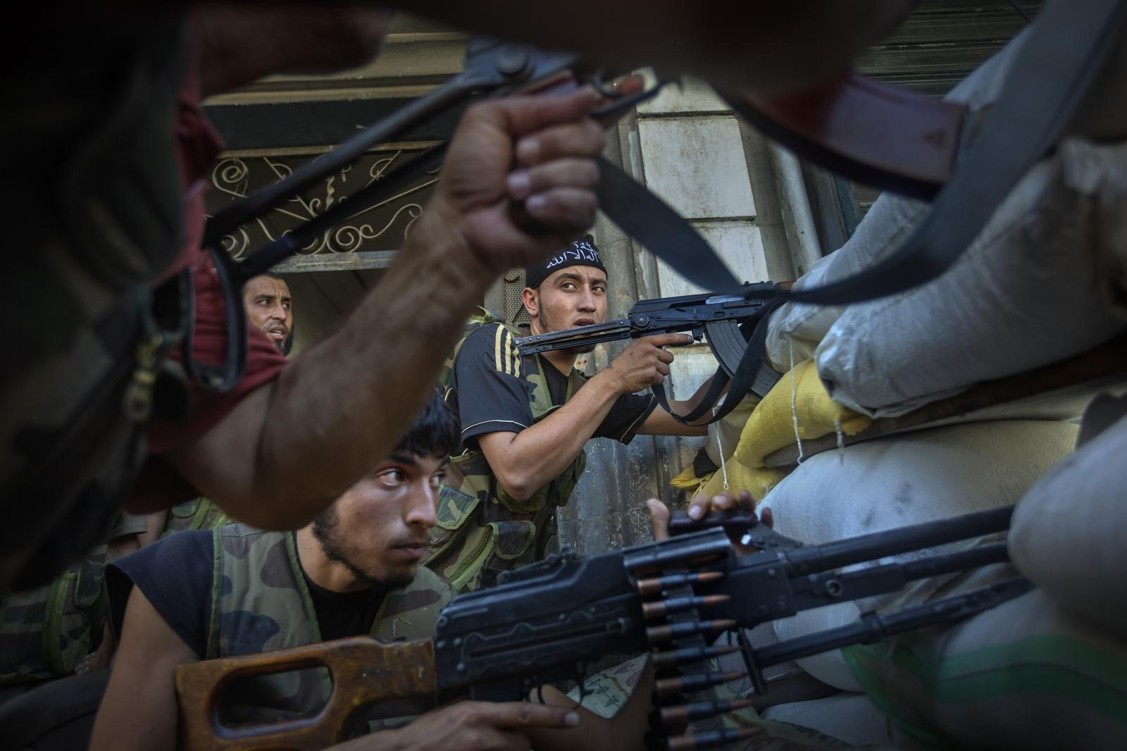 Free Syrian Army (FSA) soldiers engaged in a fierce battle against Assad's troops in Aleppo's Old City (Syria, 2012)