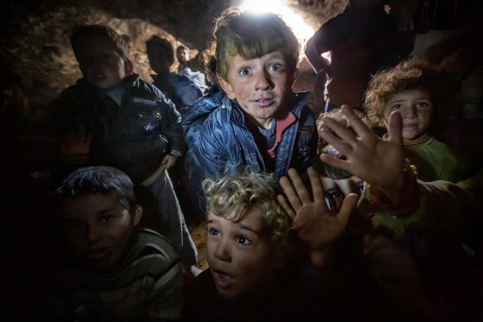 Of the nearly 400 people who had taken refuge inside the caves in Idlib province, more than half were children. The people asked that their location not be revealed because they were afraid the army might bomb them. In fact, the front lines were close by and sometimes the areas around the caves were shelled. The refugees did not have enough food, medicine or adequate winter clothing, but at least the children could attend classes taught by volunteers (Syria, 2013)
