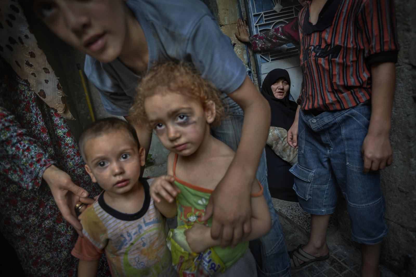 A girl with here with her eye makeup ruined by tears brought on by fear of the bombings ( in this case from a helicopter ). Aleppo ( Syria 2012 )