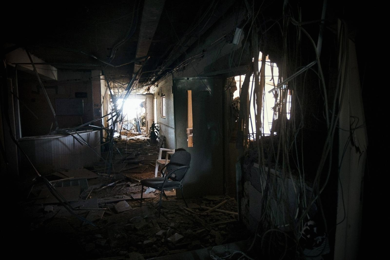 The inside of abandoned hospital ( above ) in Deir ez - Zor . This city was already divided by checkpoints that separated it into different zones controlled by the Free Syrian Army (FSA), Jabath al-Nusra (Al Qaeda in Syria) and ISIS.The other half of the city was under the control of the Assad regime ( Syria , 2013 ) .