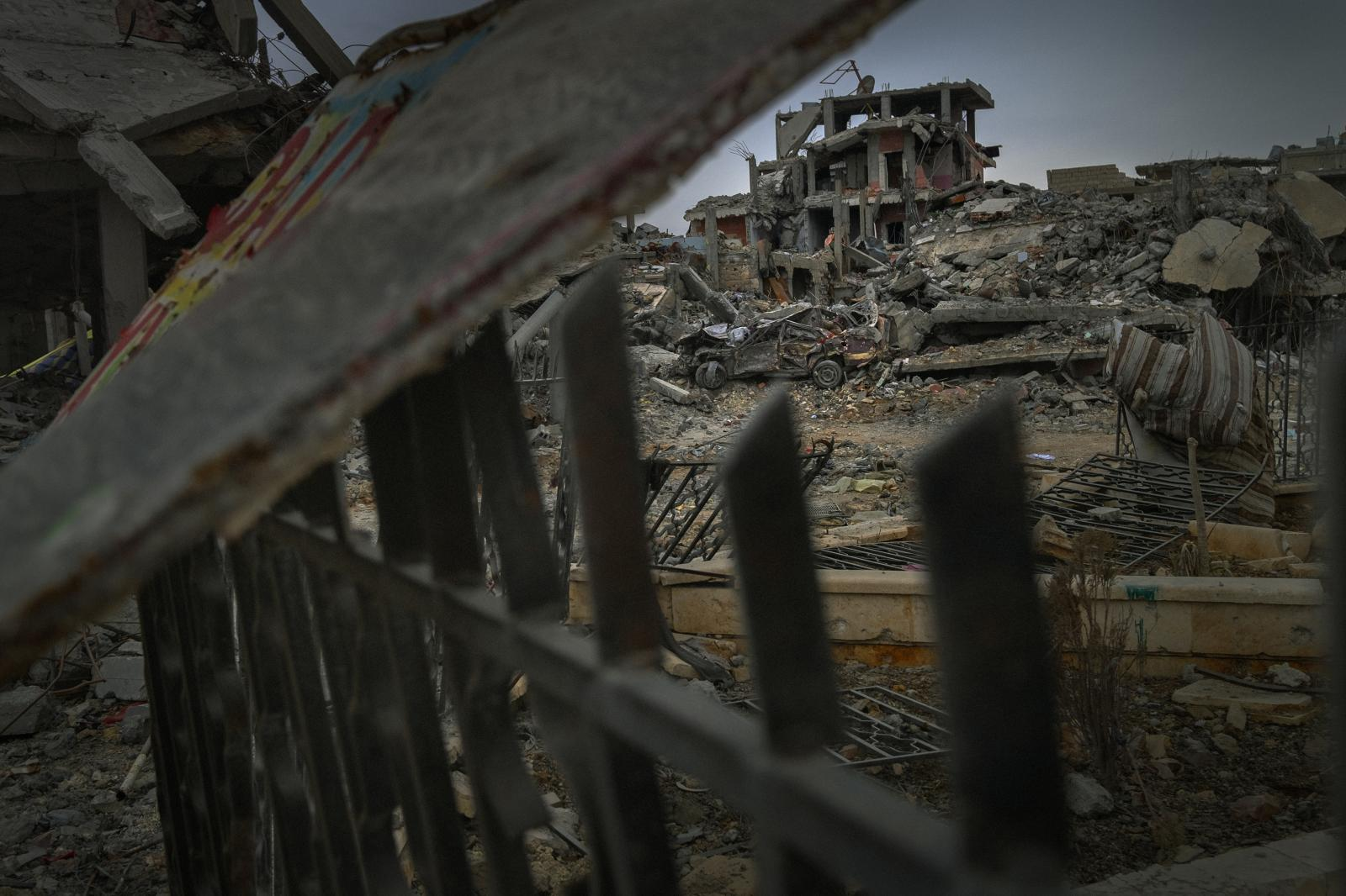 Image of the destroyed main street in the city of Kobane . Seventy percent of the city was reduced to ruins in the battle against ISIS . Today, entire buildings still have yet to be rebuilt. This battle marked the first major defeat for ISIS (Syria, 2015 )