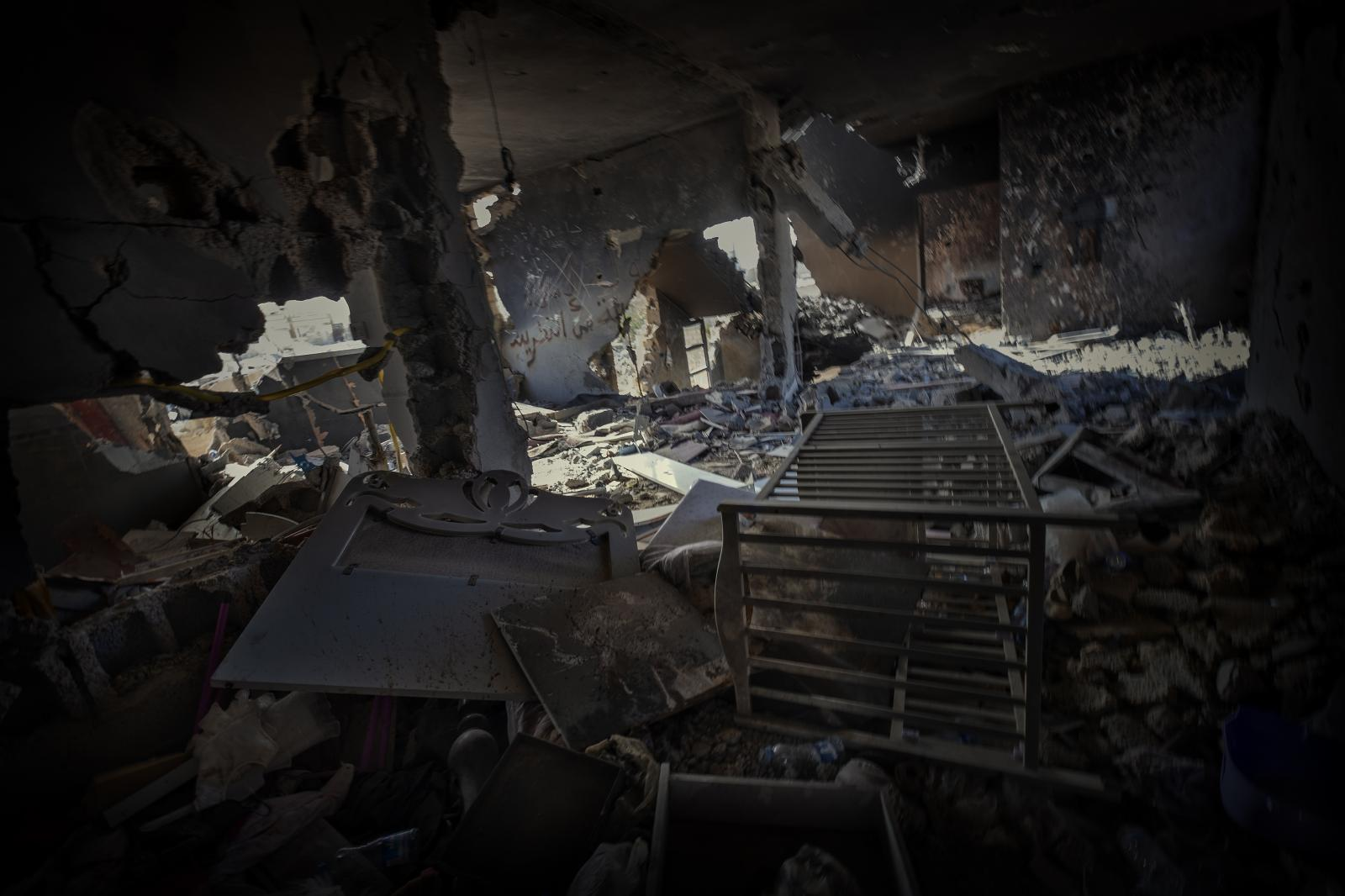 A room that had belonged to a child destroyed in the fight against ISIS in Sirte. The remains of a crib can still be seen (Libya, 2016)
