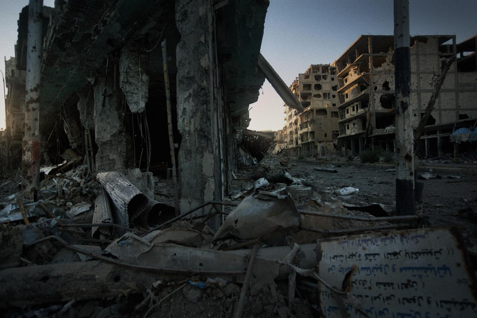 One of the main streets in Deir ez-Zor, a city which was under constant shelling by Assad's troops.Five seconds after taking this picture, a projectile exploded in this exact place (Syria, 2013)