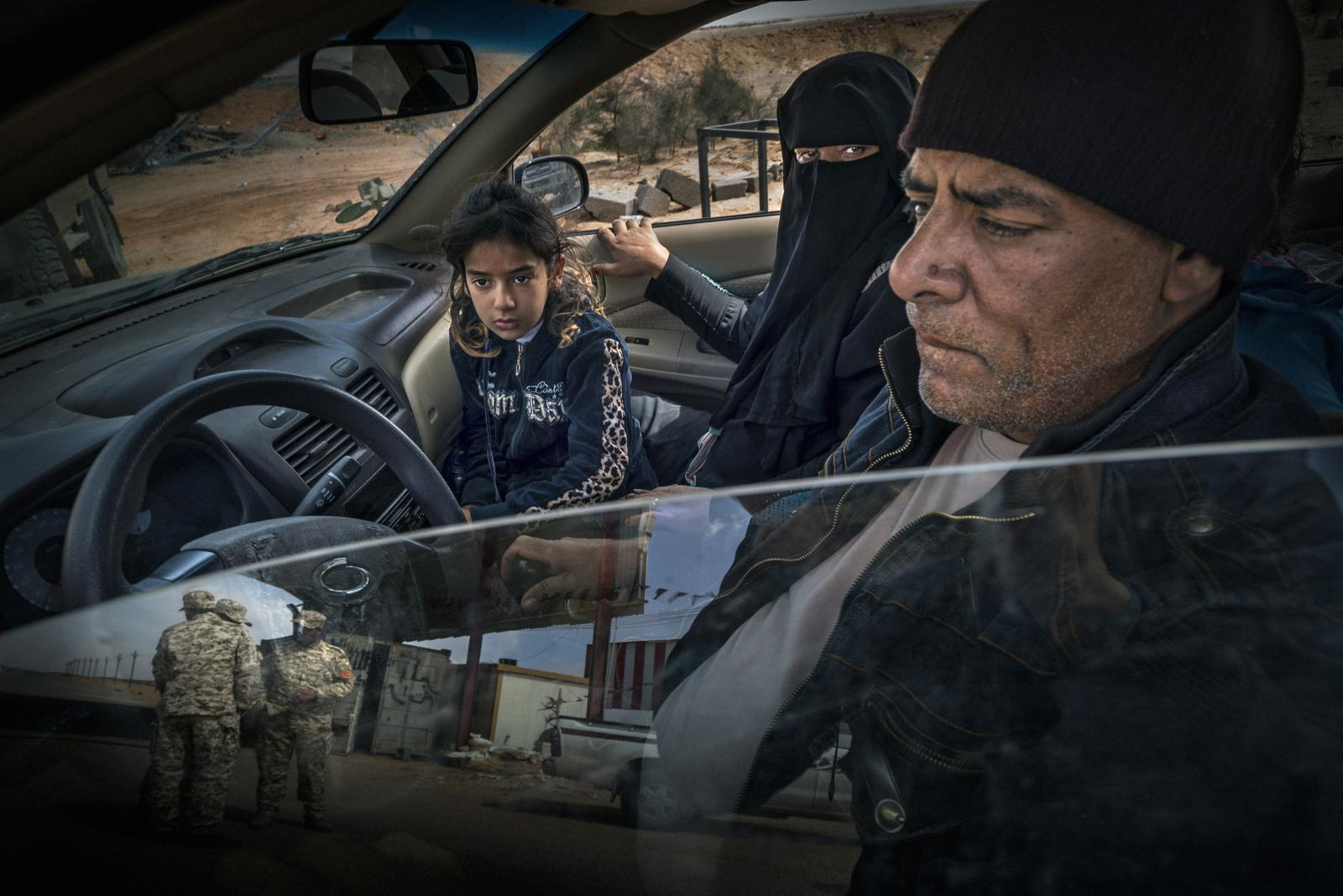Family in a car from Sirte, at that time under ISIS control, at a military police and Brigade 166 checkpoint in Abu Grein. ISIS had launched a coordinated attack there involving the Al-Bagla checkpoint that signaled the beginning of the Sirte campaign (Libya, 2016)