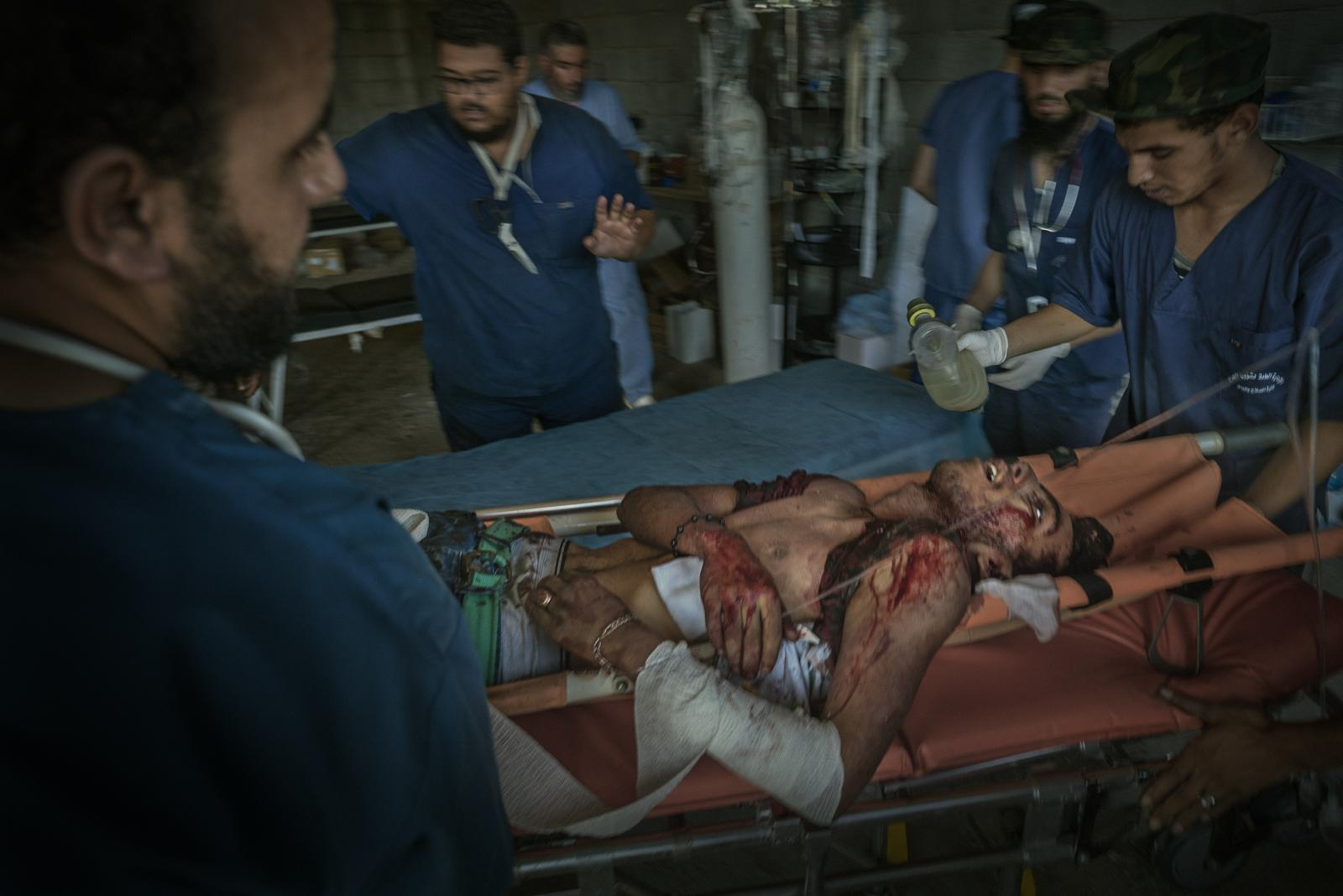 A soldier of the Government of National Accord ( GNA) at the time of his death caused by the explosion of a DOGMA (ISIS suicide car bomb) in a field hospital during the battle of Sirte (Libya, 2016)