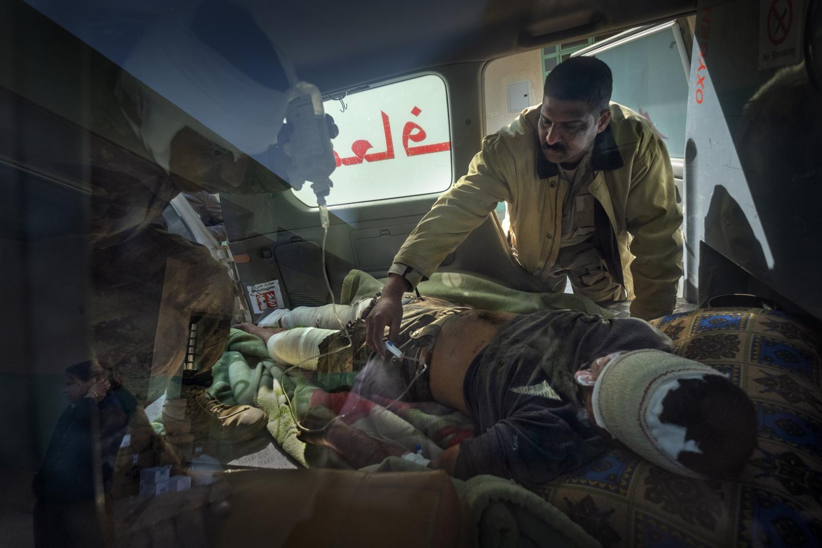 Ambulance with wounded in a field hospital. Once stabilized, the injured are transferred to a larger hospital. Southwestern front, battle of Mosul (Iraq, 2017)