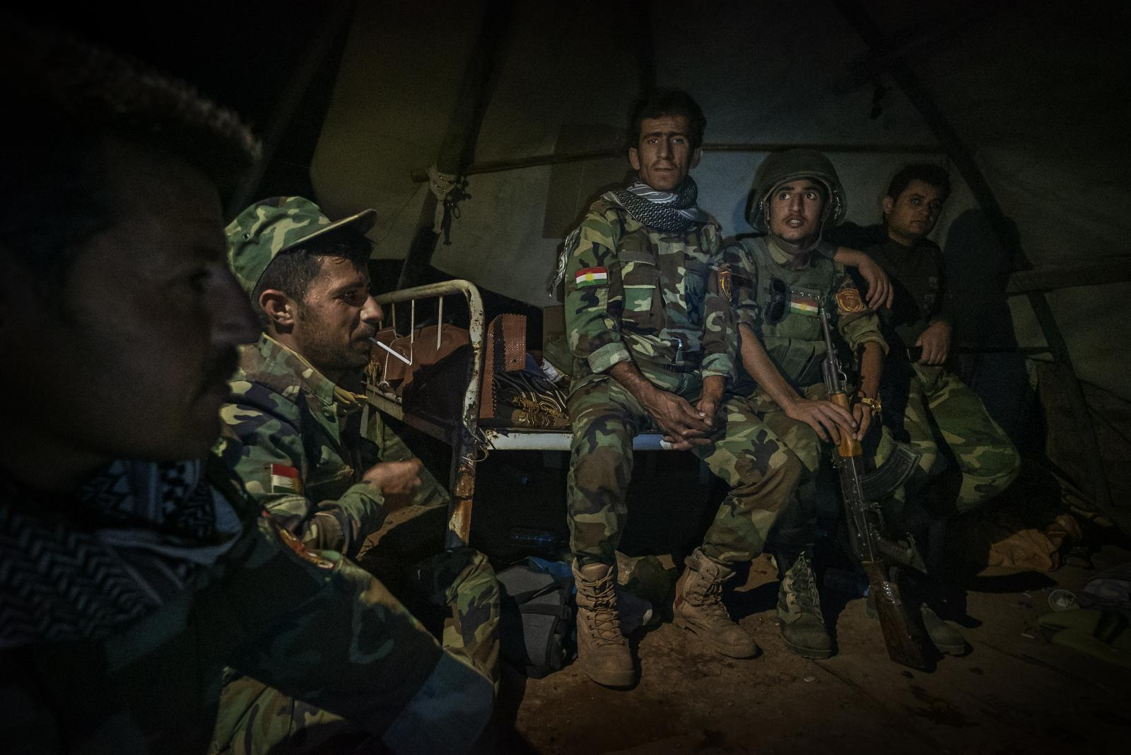 Peshmerga soldiers (those who face death) on alert for a possible night raid by Islamic State fighters rest in a trench on the front lines near Khazir (Iraq, 2016)