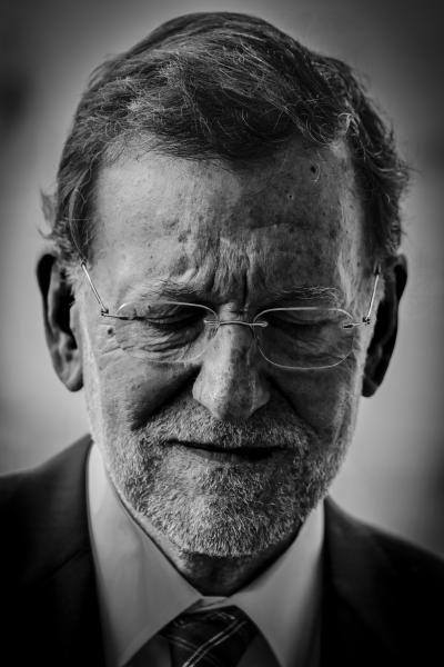 y. Mariano Rajoy, Prime Minister of Spain, with eyes closed