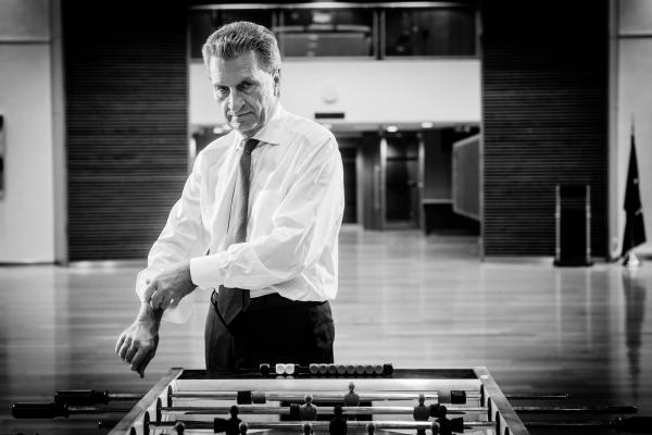 portrait of Gunther Oettinger at his after-work activity playing Table football training for the yearly team competion. Pulling up the sleeves of his shirt.