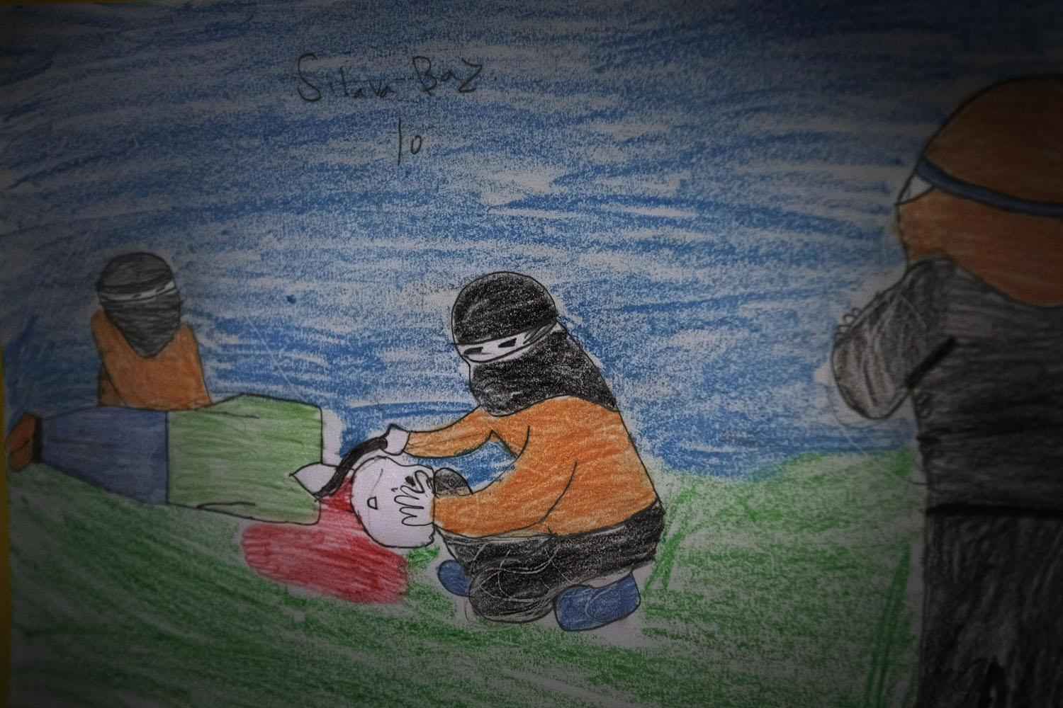 10-year-old Silava Baz, from the city of Kobane, drew this scene of a beheading at the hands of ISIS in a refugee camp in Suruç near the Syrian border (Turkey, 2015).