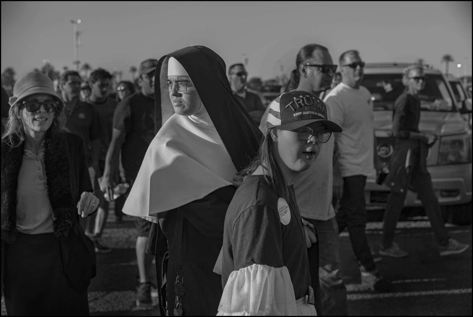 A Catholic nun with her young student. Presidential campaign event, Phoenix, AZ USA. February 2020.