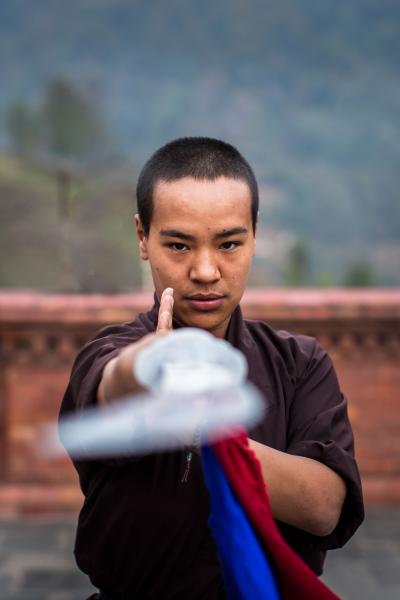 "Jigme Konchok Lhamo, 25, from Himachal Prasesh, India, became a nun in 2006. She has been learning Kung Fu since eight years. ""His Holiness believes in the strength of the body. He supports us and sees sports activities as an addition to our spiritual studies. Kung Fu is mental training. It makes you stronger and more confident. We demonstrate Kung Fu and teach girls, for whom self-defense can be very important. Actually kung fu is not for fighting or causing pain; it is for self-defense"". Kathmandu, Nepal, April 1, 2019. ------------ From the ongoing series 'The Kung Fu Nuns of the Himalayas'"