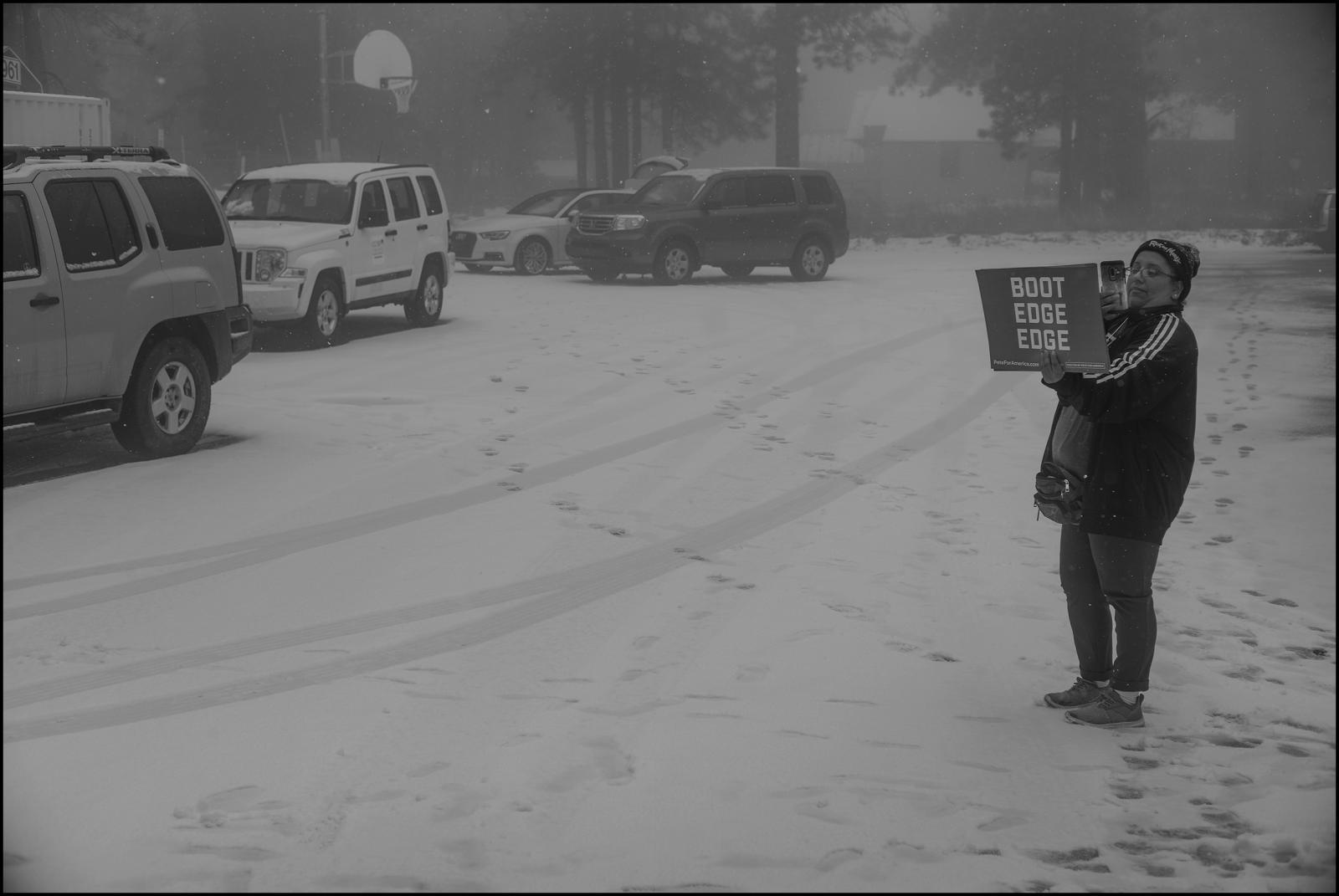 Volunteer/observer Abril Villanueva in snowstorm in the mountaintop village of Mt. Charleston, Clark County Nevada. February 2020.