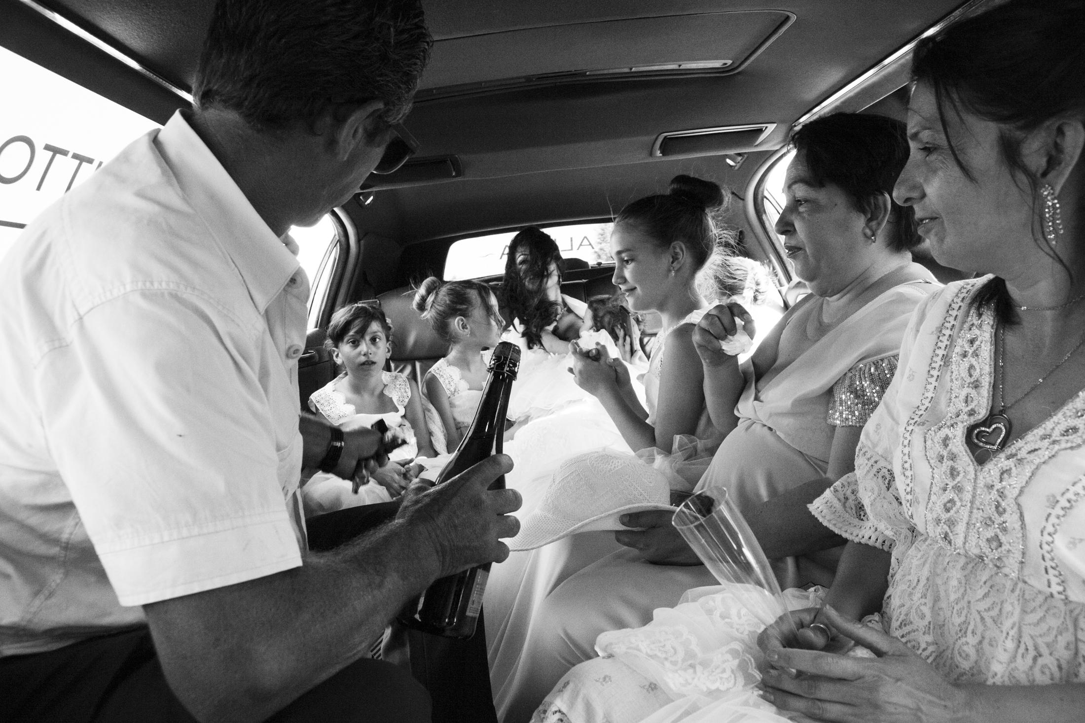June 2019, Castelnuovo Rangone, Emilia-Romagna, Italy. Nancy and her family are inside the limo that's taking them to the church for the wedding. Thanks to the great spread of the evangelical religion, many traditions within the Sinti culture are changing, thus facilitating social inclusion.