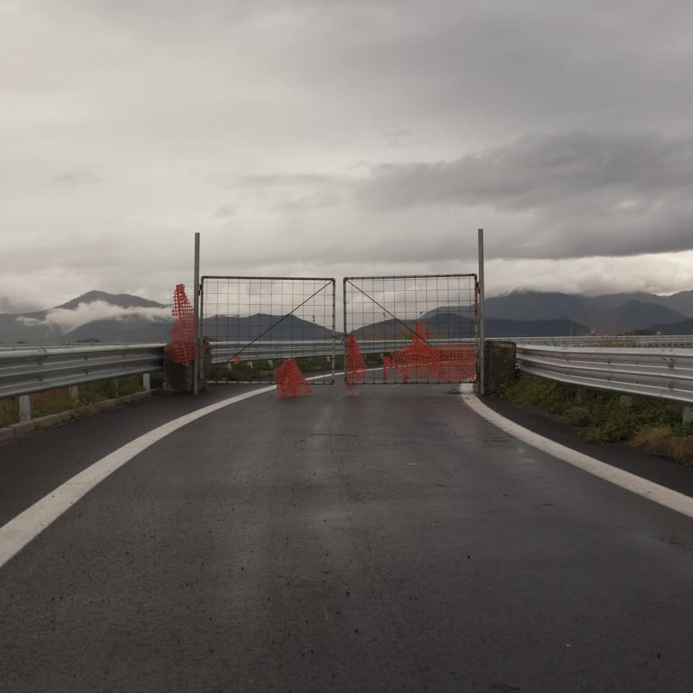 San Marzano Sul Sarno, Salerno, November 2018. Entrance to the ring road closed due to flooding due to the overflow of a canal in the Sarno river basin. The cementing over the years of the illegally poured substances led to the raising of the river bed and its channels, creating several floods during rainy days.