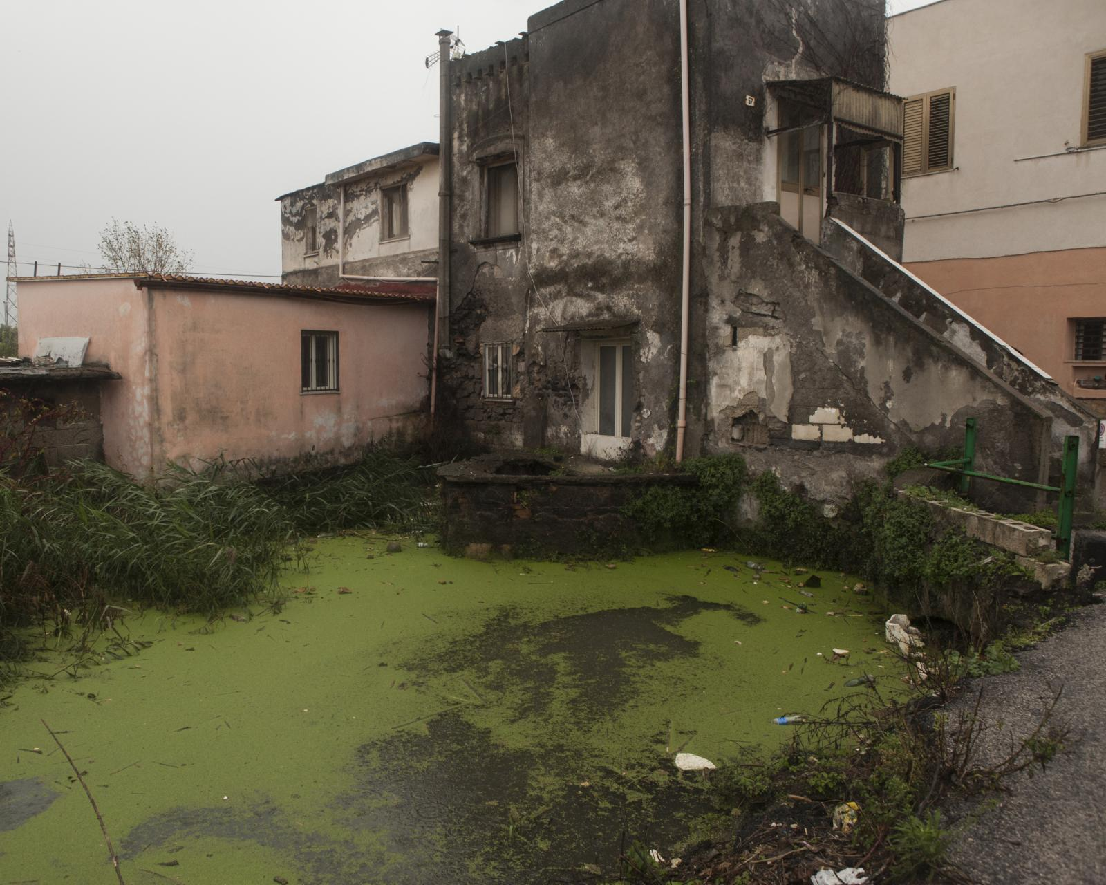 Scafati, November 2018. View of a house that stands on one of the canals that cross the city. During the winter rains these canals often overflow and transport solid waste and chemicals from upstream tributaries.