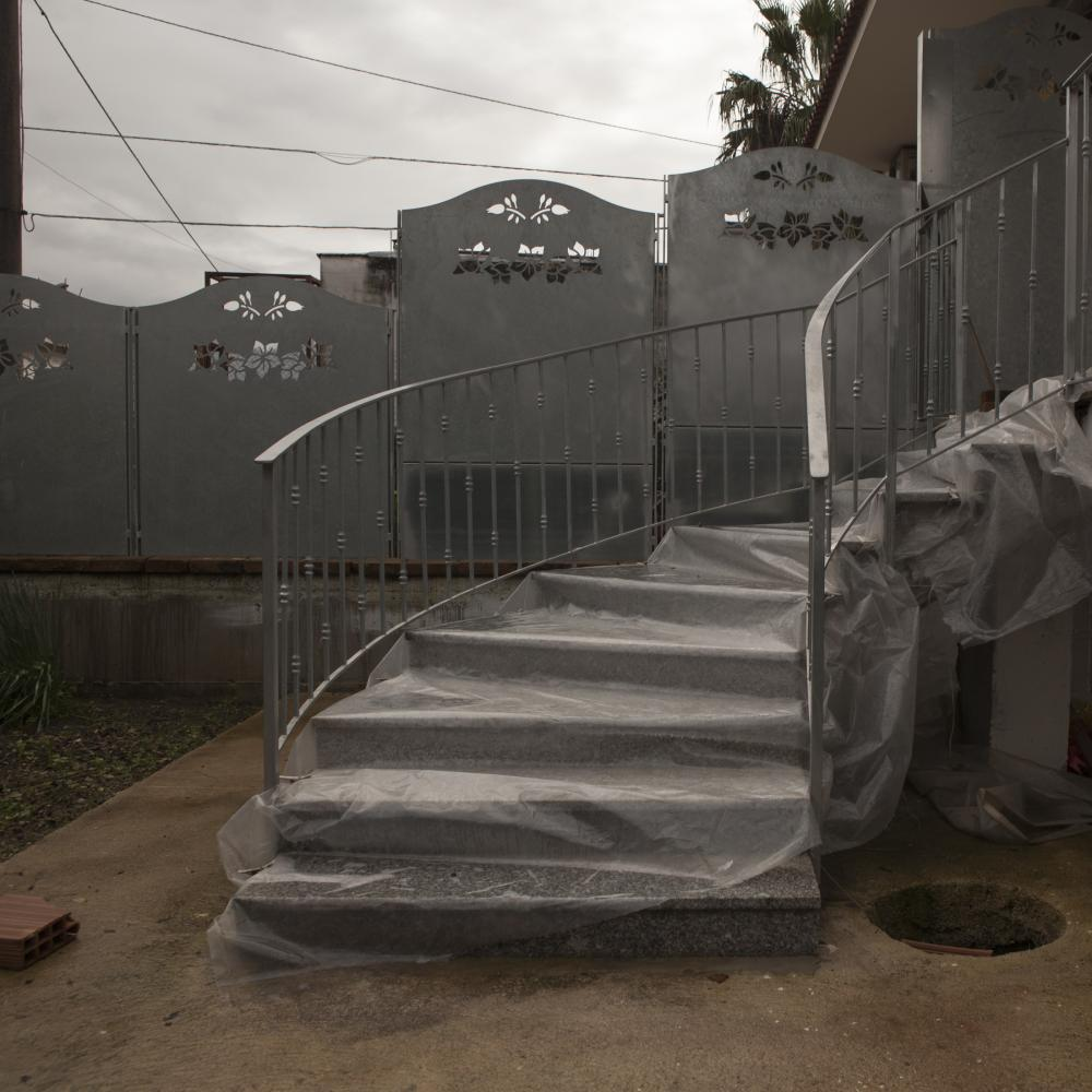 San Marzano Sul Sarno, Salerno, November 2018. Staircase of a house that stands on the Sarno River. The cementing of illegally poured chemicals over the years has led to the raising of the river bed and its canals, creating several floods during rainy days.