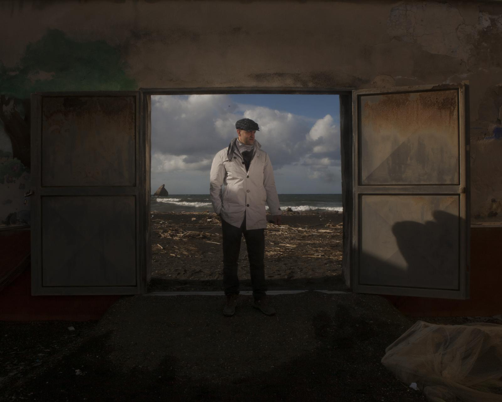 Torre Annunziata, November 2018. David poses for a portrait in front of the beach. He is part of an association that deals with the cleaning of beaches from waste brought from the sea. In fact, all the chemical and solid waste from the river that spills into the sea makes almost 10km of coast between the Gulf of Naples and the Amalfi Coast unfit for bathing because of the currents that send this waste back to shore and make the water polluted and harmful to health.