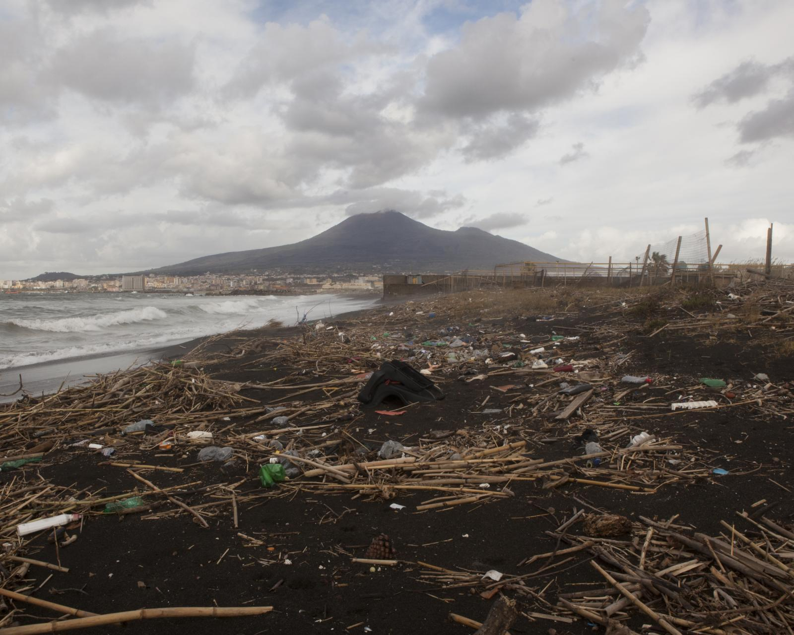 Torre Annunziata, November 2018. View of Vesuvius with garbage heap on the beach. All the chemical and solid waste from the river pours into the sea, making almost 10km of coast between the Gulf of Naples and the Amalfi Coast unfit for bathing, due to the currents that send this waste back to shore and make the water polluted and harmful to health.