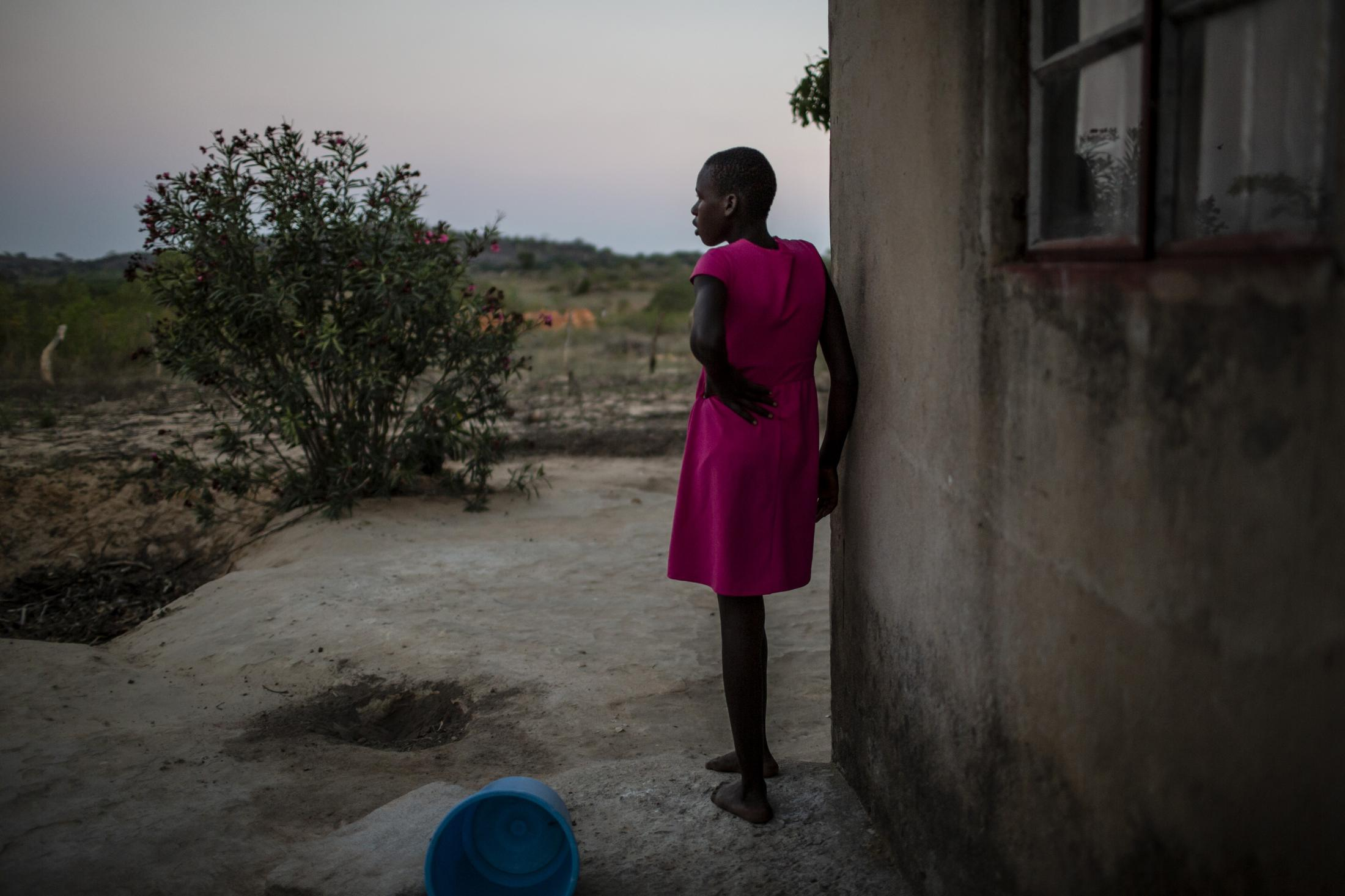 Lana Fariva (14) is pictured at her home which is 7kms away from the R4 Rural Resilience Project in Masvingo, Zimbabwe on October 07, 2019. The family has no electricity or water at home and have to walk for over a km to a spring to fetch water everyday. They have no choice but to use this for drinking and cooking as well, so it will be boiled. The project has benefitted them greatly, providing fresh fish and vegetables for the family. Tariro has also gained a lot of knowledge about farming and financial literacy and is able to implement these strategies in other aspects of her life. She has now started her own poultry and goat farming initiative.
