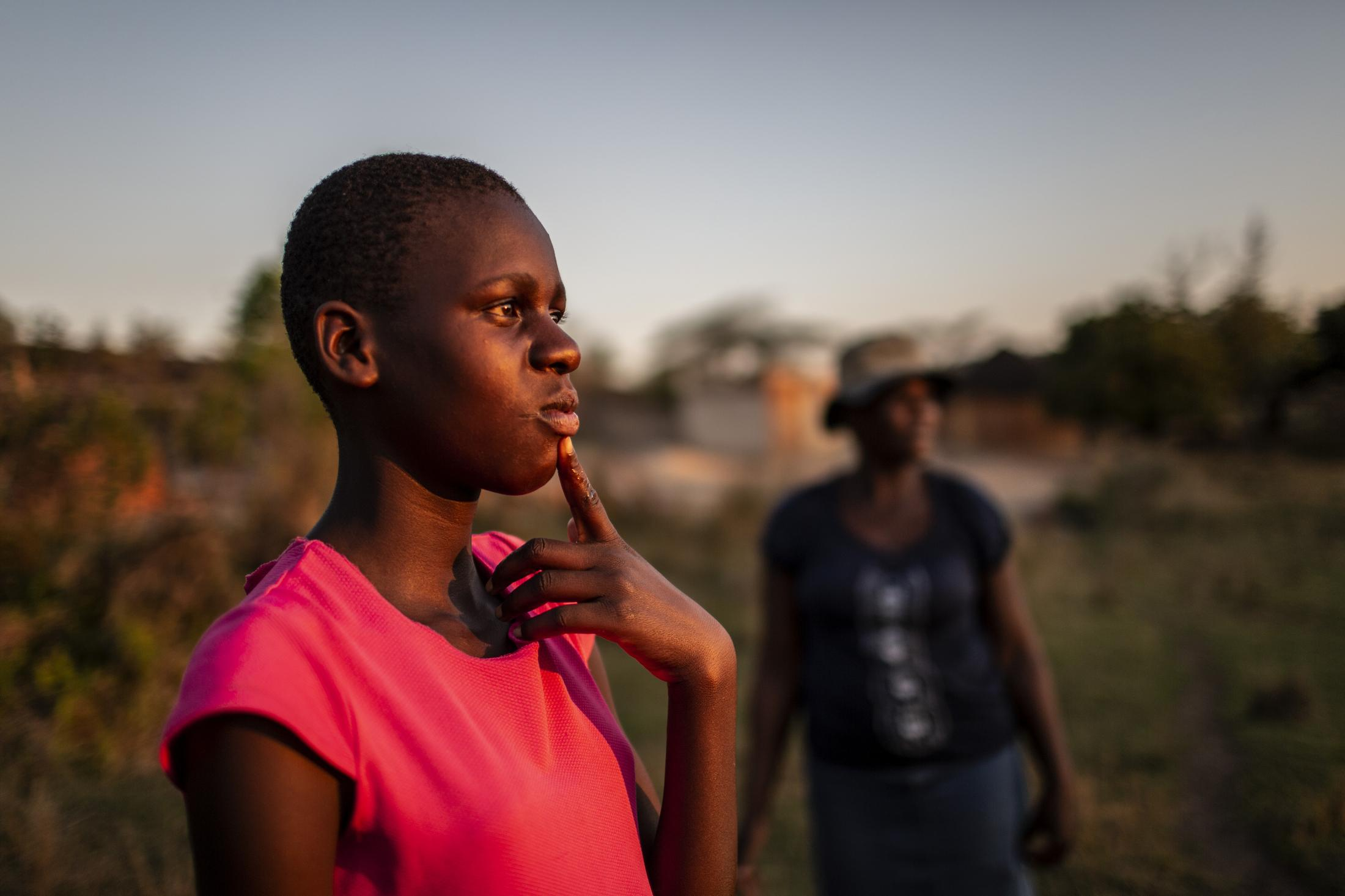 Lana Fariva (14) is pictured with her mother Tariro Chinamo (43) while fetching water from a spring in Masvingo, Zimbabwe on October 07, 2019. The family has no electricity or water at home and have to walk for over a km to a spring to fetch water everyday. They have no choice but to use this for drinking and cooking as well, so it will be boiled.