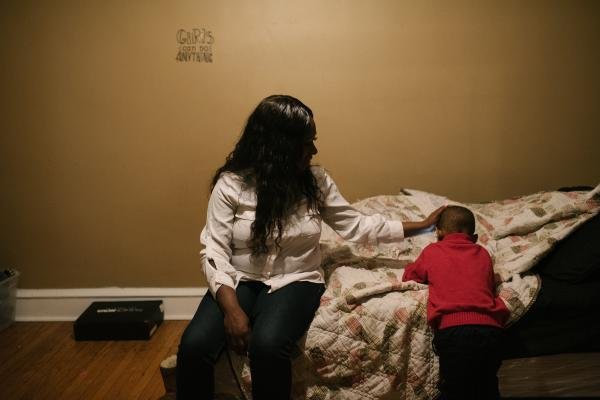 Shanaya Ball, 27, pats her son, Amari Shuler, 2.5, on the head at her home in Philadelphia, PA. on Thursday, February 20, 2020. Ball discovered high lead levels in her son after she received a notification from the city that her home had high levels of lead. She wonders if this could be why her son has autism and developmental issues.