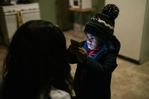 Shanaya Ball, 27, left, helps her son, Amari Shuler, 2.5, get ready for daycare at her home in Philadelphia, PA. on Thursday, February 20, 2020. Ball discovered high lead levels in her son after she received a notification from the city that her home had high levels of lead. She wonders if this could be why her son has autism and developmental issues.