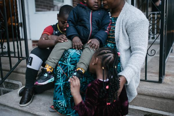 Fatu Kante, right, sits with her children (left to right), Kemo, 9, Aly, 2, and Sera, 4, at their home in Philadelphia, PA. on Monday, February 25, 2020. The two youngest, Sera and Aly, were found to have lead poisoning due to the old paint in their current home. Hannah Yoon