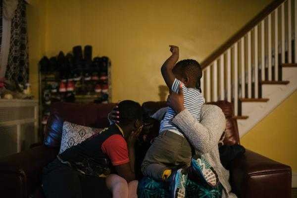 Fatu Kante, right, sits with her children (left to right),Kemo, 9, Sera, 4, and Aly, 2, at their home in Philadelphia, PA. on Monday, February 25, 2020. The two youngest, Sera and Aly, were found to have lead poisoning due to the old paint in their current home. Hannah Yoon
