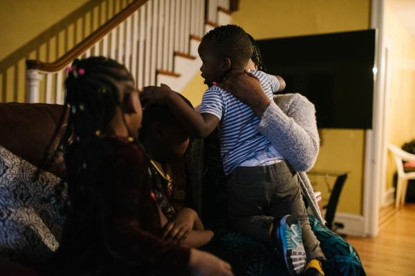 Fatu Kante, right, plays with her children (left to right),Kemo, 9, Sera, 4, and Aly, 2, at their home in Philadelphia, PA. on Monday, February 25, 2020. The two youngest, Sera and Aly, were found to have lead poisoning due to the old paint in their current home. Hannah Yoon