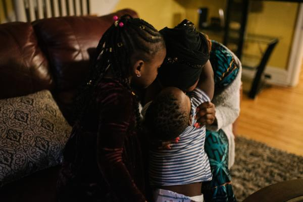 Fatu Kante sits with her son, Aly, 2, and daughter Sera, 4, at their home in Philadelphia, PA. on Monday, February 25, 2020. Both Sera and Aly were found to have lead poisoning due to the old paint in their current home. Hannah Yoon
