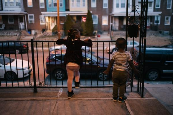 Siblings Sera, 4, left, and Aly, 2, wait for their dad at their home in Philadelphia, PA. on Monday, February 25, 2020. Both were found to have lead poisoning due to the old paint in their current home. Hannah Yoon